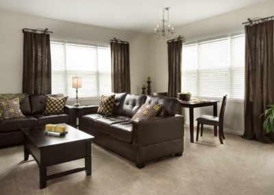 decorated living room of a Warminster apartment rental at The Station at Bucks County